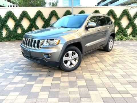 2012 Jeep Grand Cherokee for sale at ROGERS MOTORCARS in Houston TX