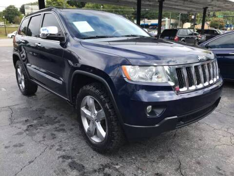 2013 Jeep Grand Cherokee for sale at Magic Motors Inc. in Snellville GA