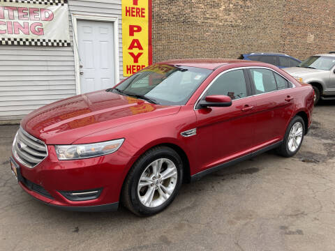 2014 Ford Taurus for sale at RON'S AUTO SALES INC in Cicero IL