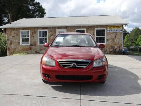 2009 Kia Spectra for sale at Flywheel Auto Sales Inc in Woodstock GA