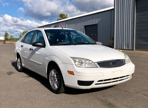 2005 Ford Focus for sale at DASH AUTO SALES LLC in Salem OR