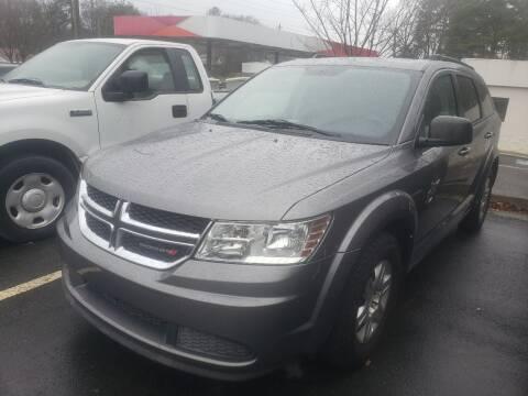 2012 Dodge Journey for sale at Credit Cars LLC in Lawrenceville GA
