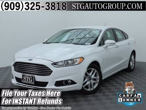 2016 Ford Fusion for sale at STG Auto Group in Montclair CA