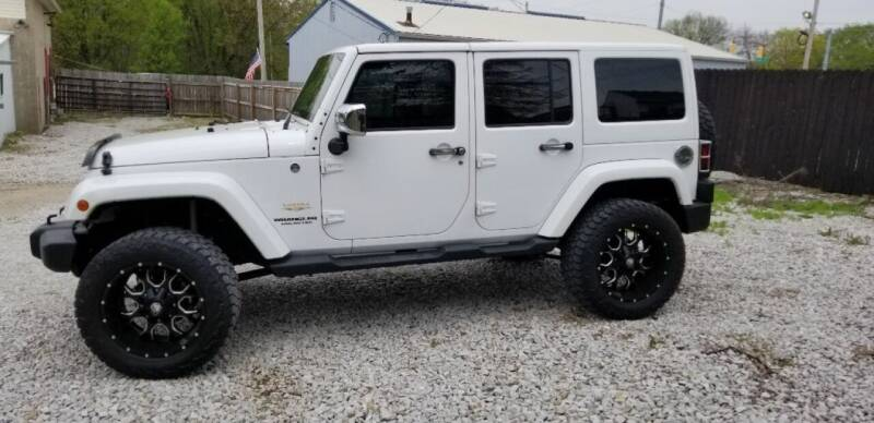 2013 Jeep Wrangler Unlimited for sale at DANVILLE AUTO SALES in Danville IN