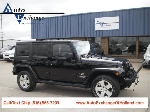 2012 Jeep Wrangler Unlimited for sale at Auto Exchange Of Holland in Holland MI