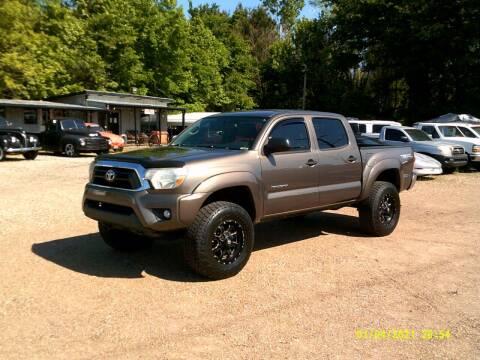 2013 Toyota Tacoma for sale at Tom Boyd Motors in Texarkana TX
