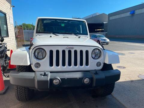 2014 Jeep Wrangler Unlimited for sale at Story Brothers Auto in New Britain CT