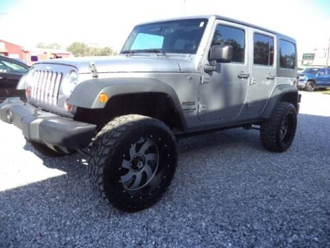2013 Jeep Wrangler Unlimited for sale at PICAYUNE AUTO SALES in Picayune MS