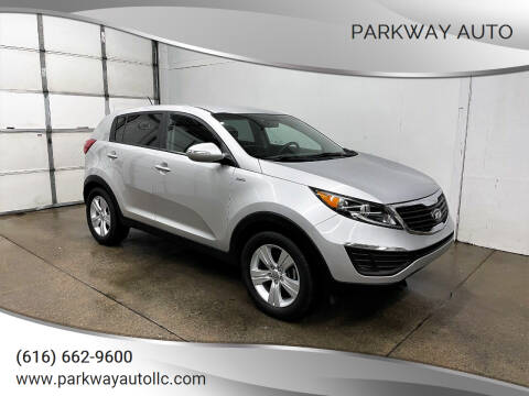 2013 Kia Sportage for sale at PARKWAY AUTO in Hudsonville MI