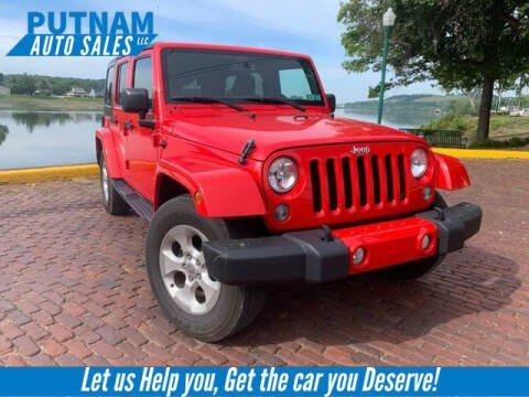 2015 Jeep Wrangler Unlimited for sale at PUTNAM AUTO SALES INC in Marietta OH
