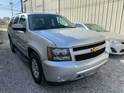 2014 Chevrolet Suburban for sale at CHEAPIE AUTO SALES INC in Metairie LA