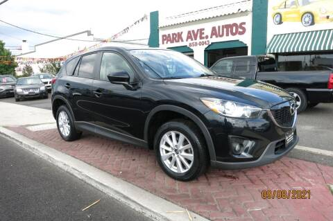 2014 Mazda CX-5 for sale at PARK AVENUE AUTOS in Collingswood NJ