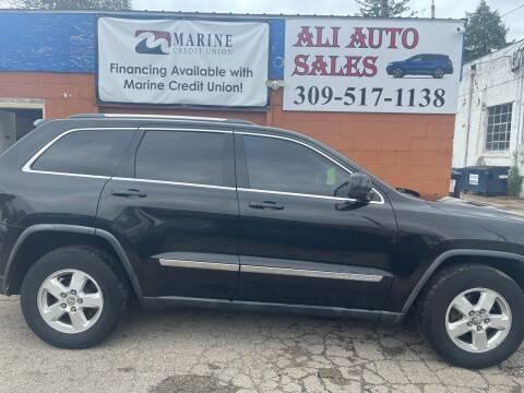 2012 Jeep Grand Cherokee for sale at Ali Auto Sales in Moline IL