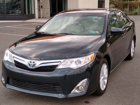 2014 Toyota Camry Hybrid for sale at MAGIC AUTO SALES in Little Ferry NJ
