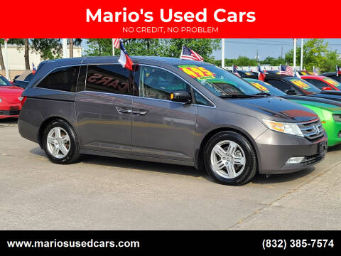 2013 Honda Odyssey for sale at Mario's Used Cars in Houston TX