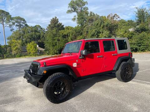 2011 Jeep Wrangler Unlimited for sale at Asap Motors Inc in Fort Walton Beach FL