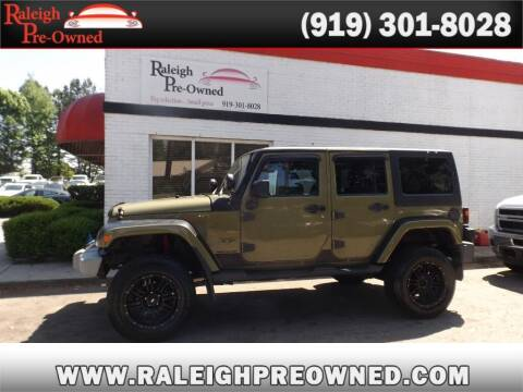 2013 Jeep Wrangler Unlimited for sale at Raleigh Pre-Owned in Raleigh NC