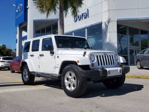 2013 Jeep Wrangler Unlimited for sale at DORAL HYUNDAI in Doral FL