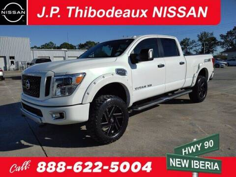 2017 Nissan Titan XD for sale at J P Thibodeaux Used Cars in New Iberia LA