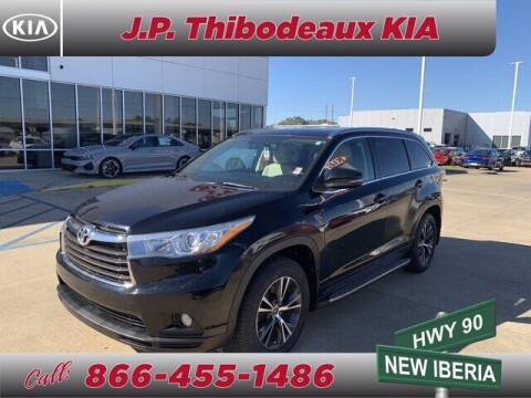 2016 Toyota Highlander for sale at J P Thibodeaux Used Cars in New Iberia LA