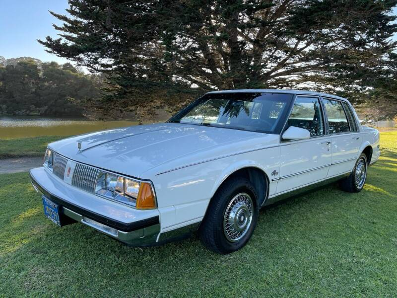 1985 Oldsmobile Ninety-Eight for sale at Dodi Auto Sales in Monterey CA