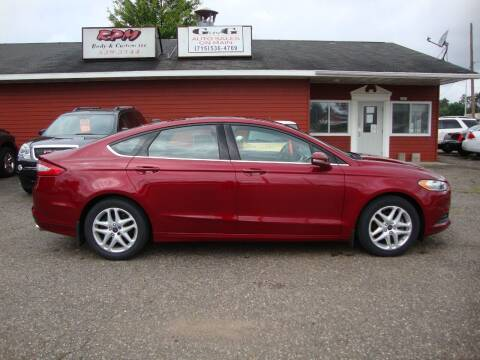 2014 Ford Fusion for sale at G and G AUTO SALES in Merrill WI