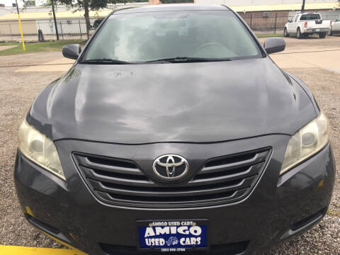 2007 Toyota Camry for sale at AMIGO USED CARS in Houston TX