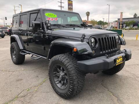 2014 Jeep Wrangler Unlimited for sale at BEST DEAL MOTORS  INC. CARS AND TRUCKS FOR SALE in Sun Valley CA