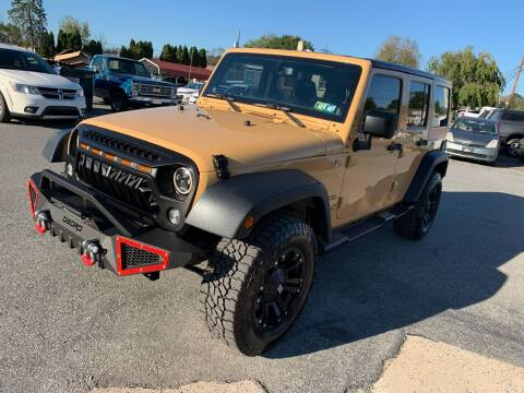 2014 Jeep Wrangler Unlimited for sale at Sam's Auto in Akron PA