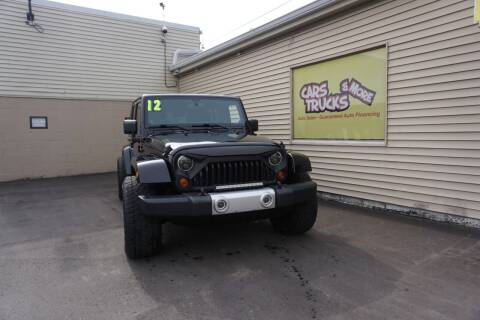 2012 Jeep Wrangler Unlimited for sale at Cars Trucks & More in Howell MI