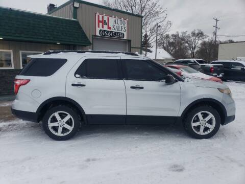 2013 Ford Explorer for sale at H & L AUTO SALES LLC in Wyoming MI