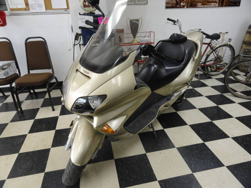 2002 Honda NSS250 for sale at John's Auto Sales in Council Bluffs IA