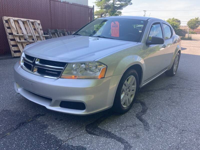 2011 Dodge Avenger for sale at D'Ambroise Auto Sales in Lowell MA