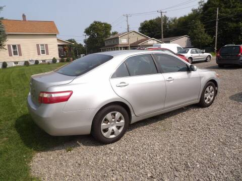 2009 Toyota Camry for sale at English Autos in Grove City PA