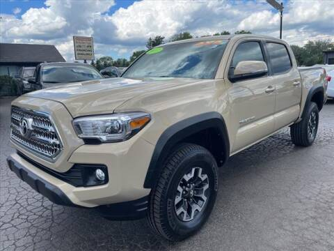 2016 Toyota Tacoma for sale at HUFF AUTO GROUP in Jackson MI