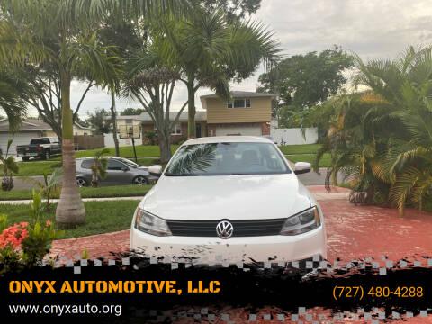 2013 Volkswagen Jetta for sale at ONYX AUTOMOTIVE, LLC in Largo FL