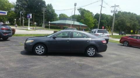 2010 Toyota Camry for sale at VINE STREET MOTOR CO in Urbana IL