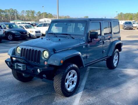 2015 Jeep Wrangler Unlimited for sale at Blum's Auto Mart in Port Orange FL