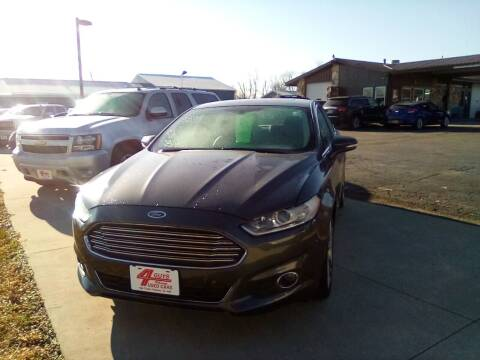 2015 Ford Fusion for sale at Four Guys Auto in Cedar Rapids IA