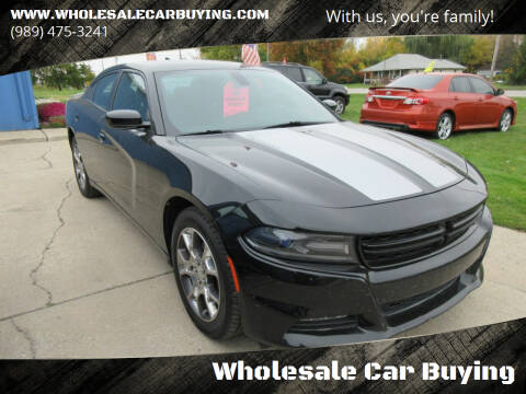 2015 Dodge Charger for sale at Wholesale Car Buying in Saginaw MI