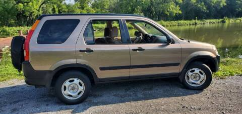 2004 Honda CR-V for sale at Auto Link Inc in Spencerport NY