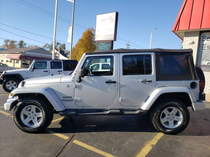 2012 Jeep Wrangler Unlimited for sale at Select Auto Group in Wyoming MI