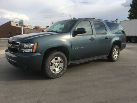 2009 Chevrolet Suburban for sale at KHAN'S AUTO LLC in Worland WY