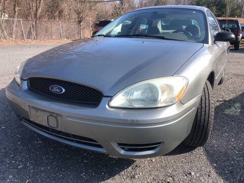 2004 Ford Taurus for sale at AUTO OUTLET in Taunton MA