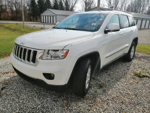 2013 Jeep Grand Cherokee for sale at KRIS RADIO QUALITY KARS INC in Mansfield OH