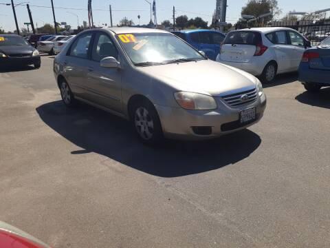 2007 Kia Spectra for sale at COMMUNITY AUTO in Fresno CA