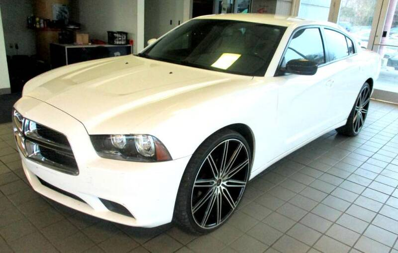 2014 Dodge Charger for sale at Pars Auto Sales Inc in Stone Mountain GA