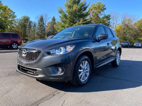 2014 Mazda CX-5 for sale at Northstar Auto Sales LLC in Ham Lake MN