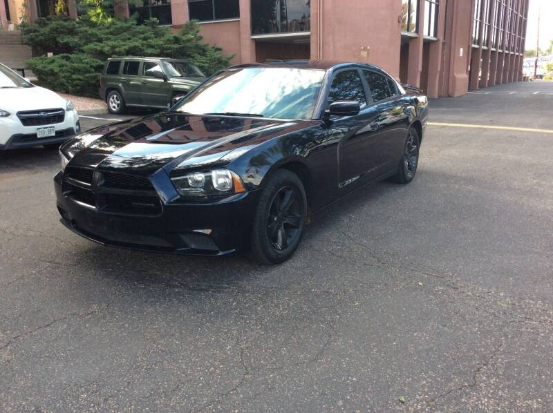 2012 Dodge Charger for sale at AROUND THE WORLD AUTO SALES in Denver CO