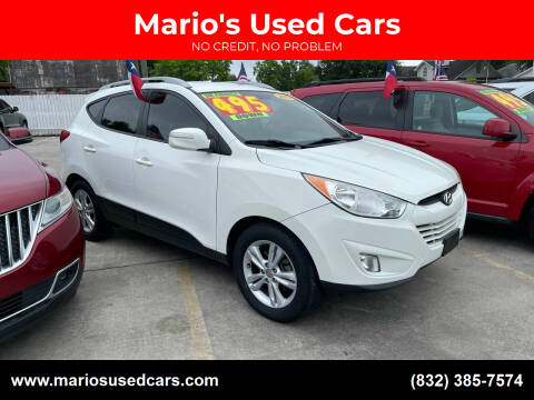 2013 Hyundai Tucson for sale at Mario's Used Cars - South Houston Location in South Houston TX